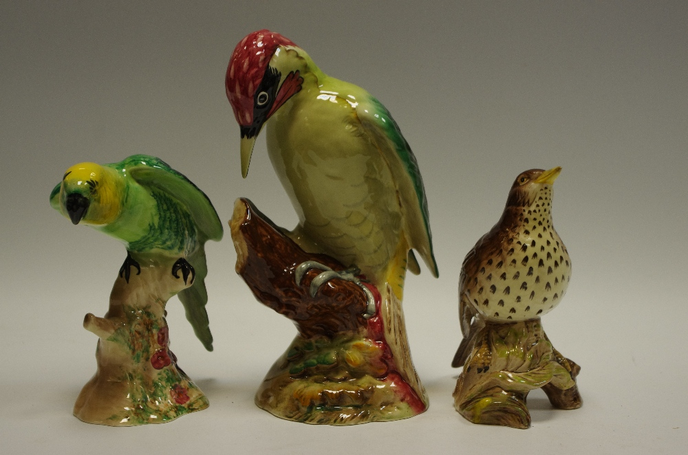 Lot 43 - A Beswick model of a woodpecker;