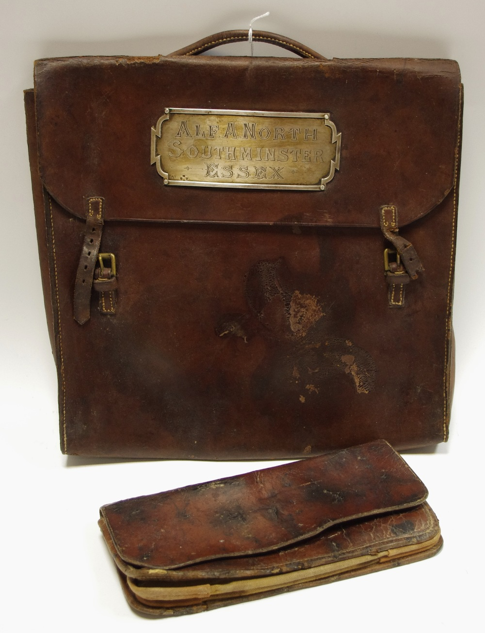 Lot 27 - A leather satchel mounted with a silver plaque inscribed Southminster Essex;