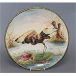 A ceramic charger painted with a Jacana standing on a lily pad by H. Deakin, Dia 32cm (worn)