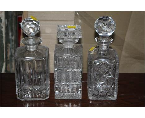 Three cut glass decanters, each of differing design