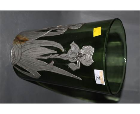 A large green glass vertically ribbed vase, with applied embossed pewter mounts depicting peonies, 24 cm high