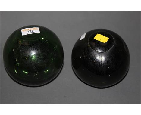 Two green glass fishing floats, a wooden mallet or masher and a turned wooden bowl.