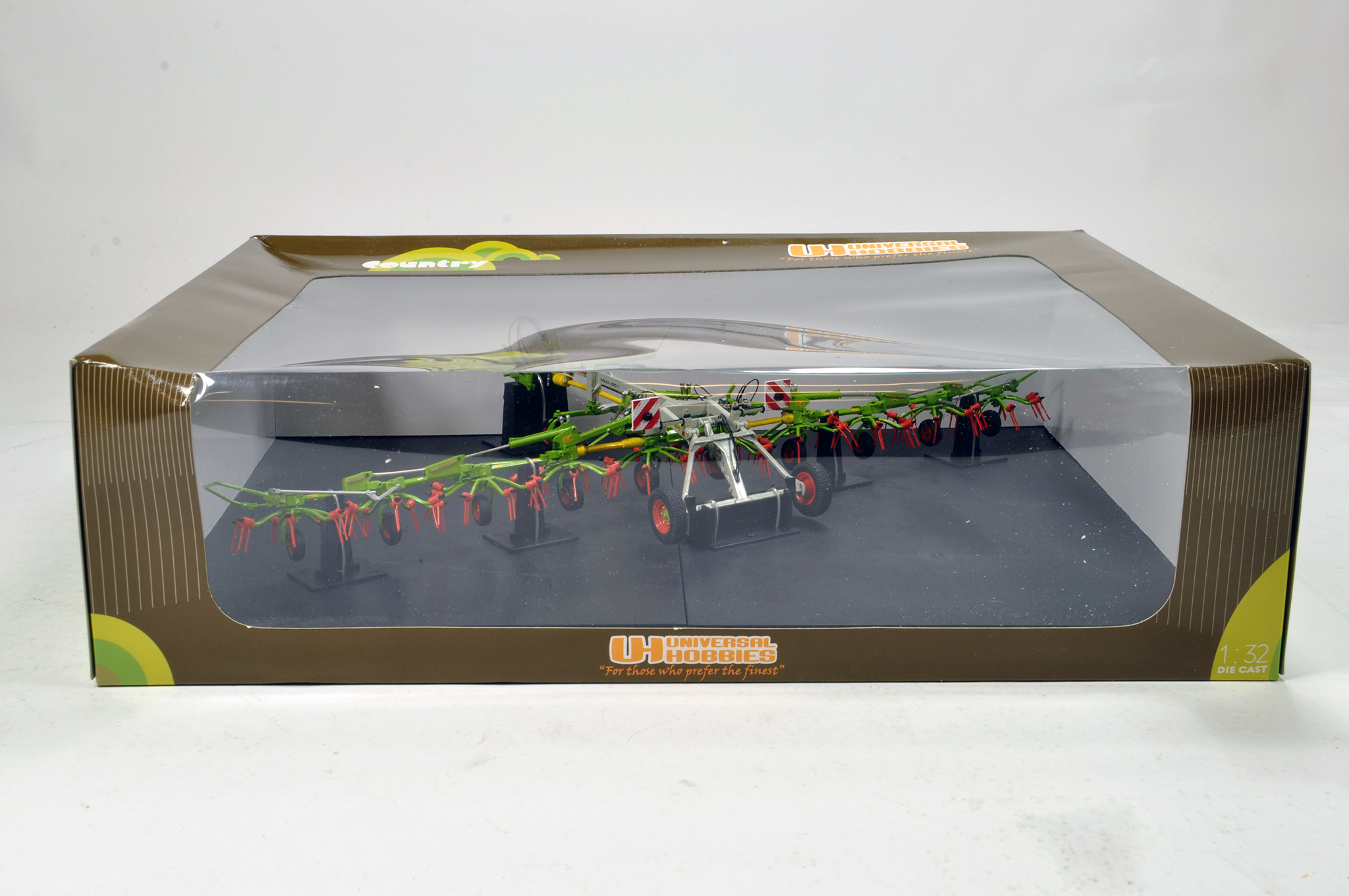 Lot 944 - Universal Hobbies 1/32 Farm Issue Comprising Claas Volto. NM in Box.