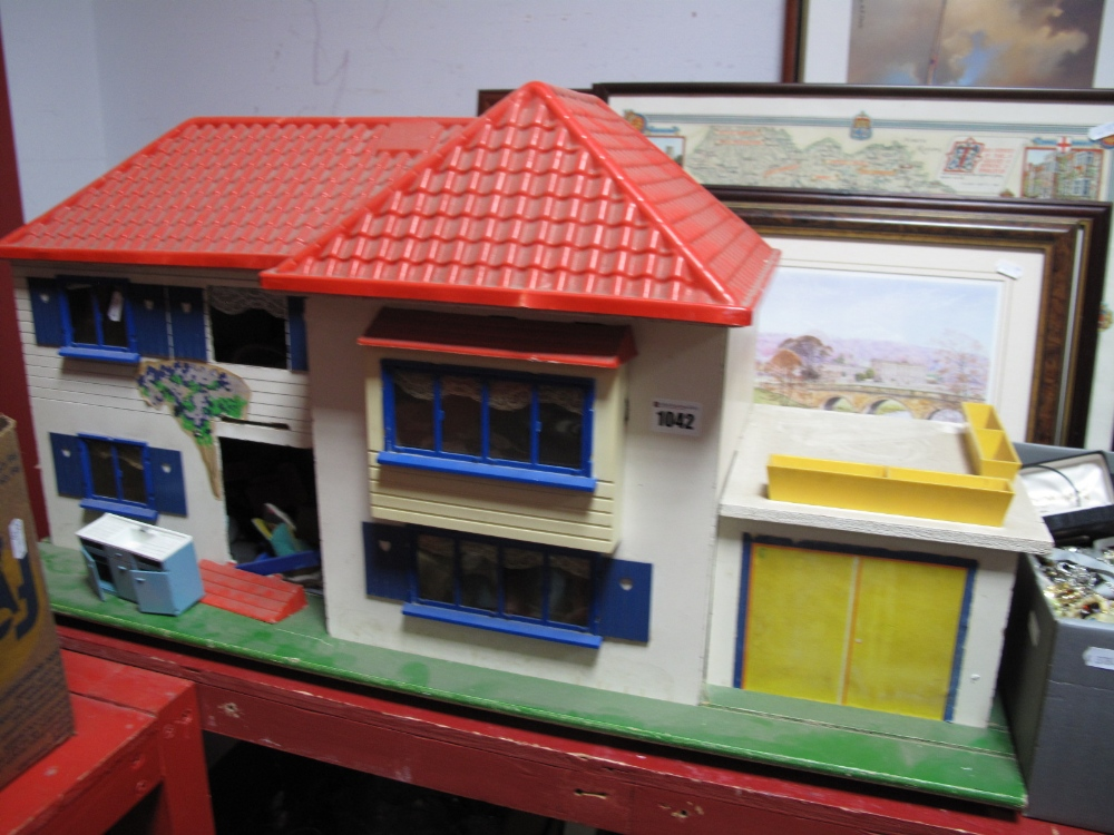 Lot 1042 - A Mid XX Century Dolls House, with a quantity of period furniture.