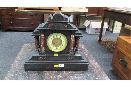 A Victorian Black Slate Mantel Clock With Rouge Marble