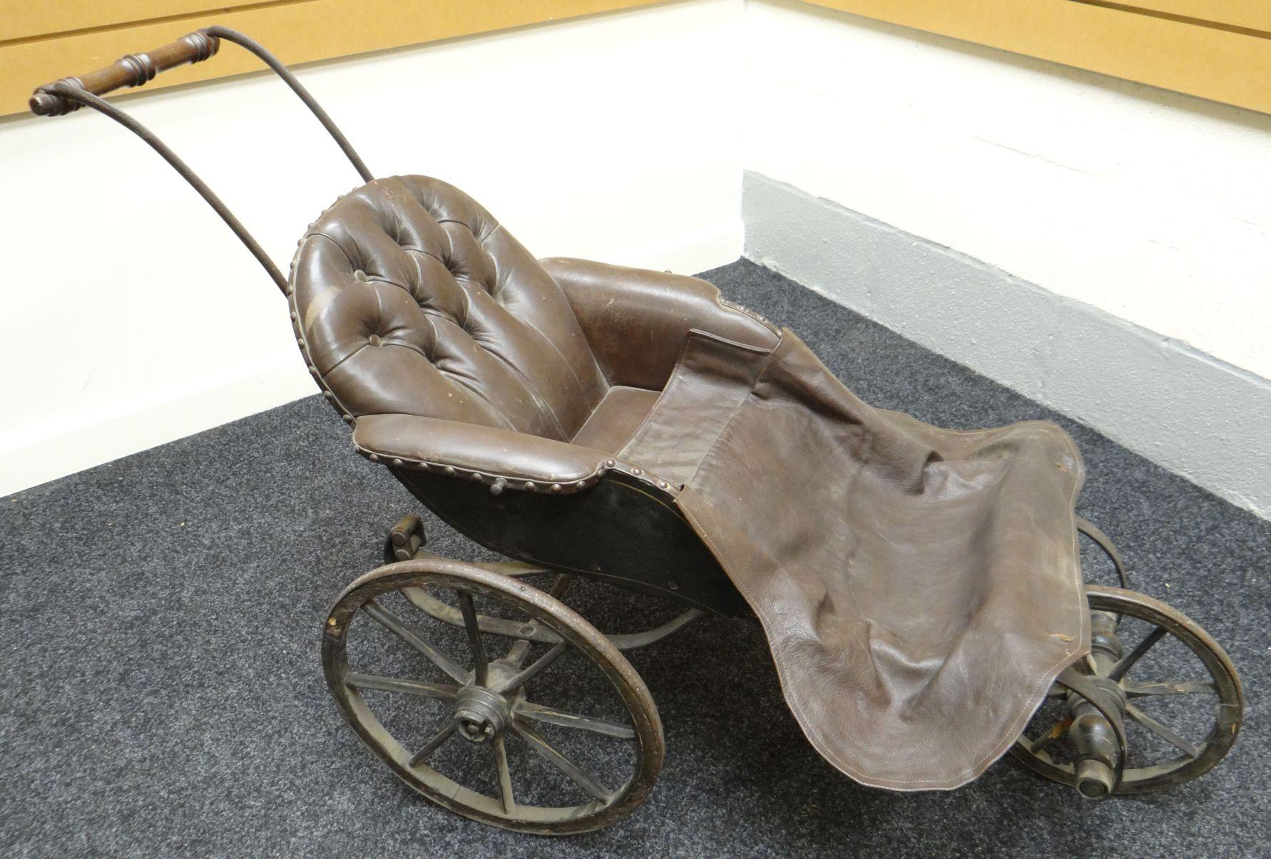 A Victorian coach built three wheel bath chair on iron springs
