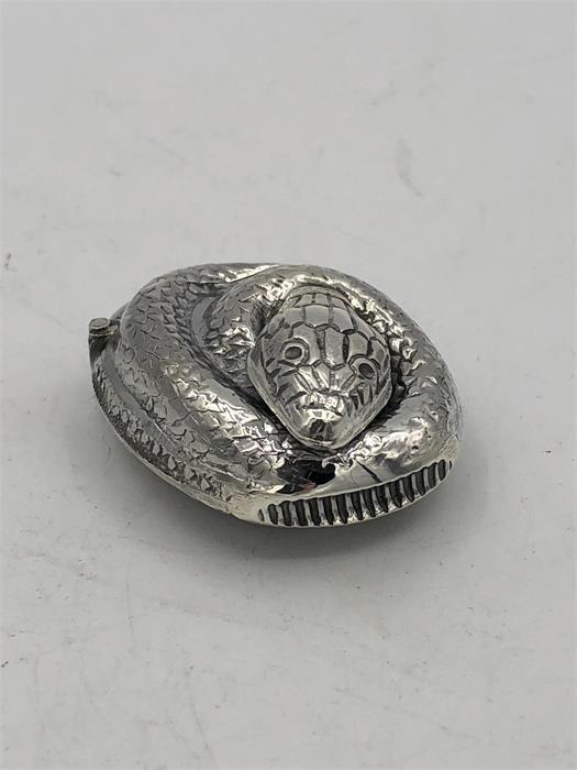 Lot 36 - An unusual silver snake shaped vesta case