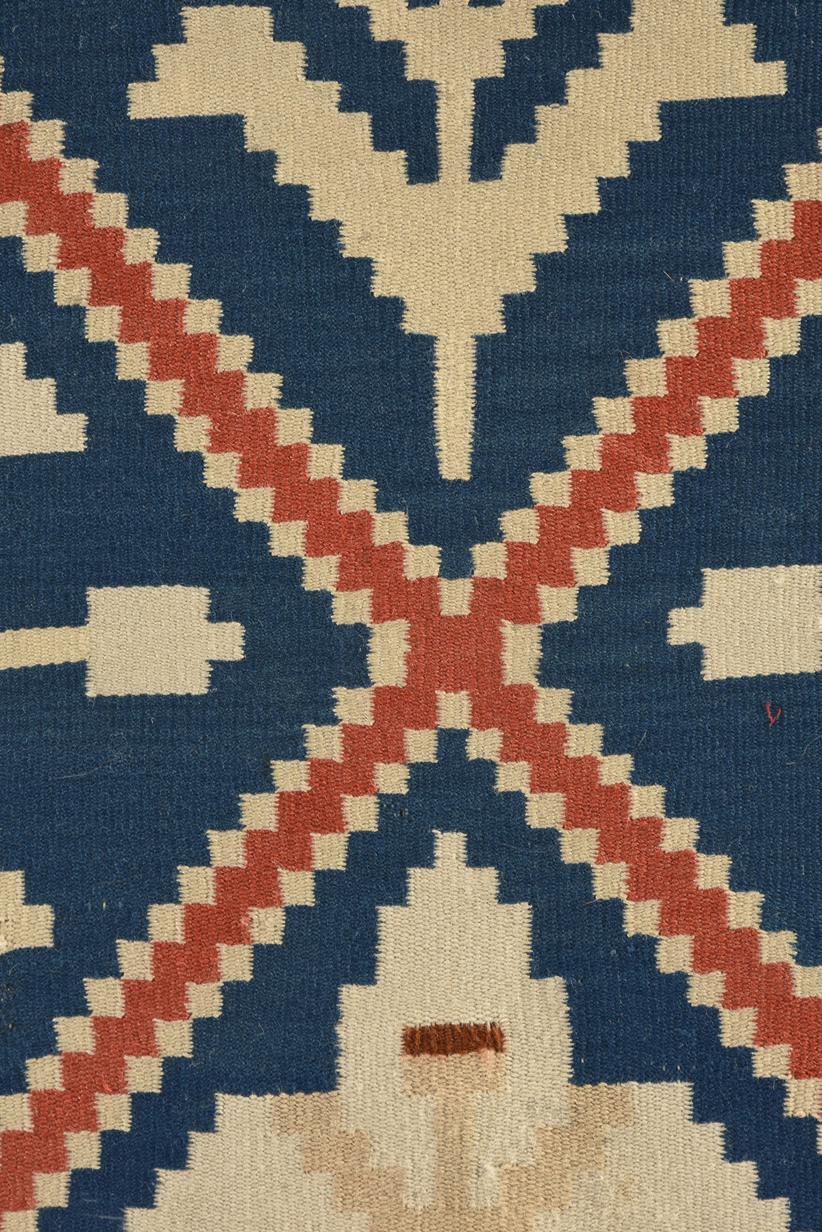 Lot 7 - A SCANDINAVIAN LILY PATTERNED FLAT WEAVE WOOL COVERLET, POSSIBLY SOGN NORWAY, EARLY 20TH CENTURY, of