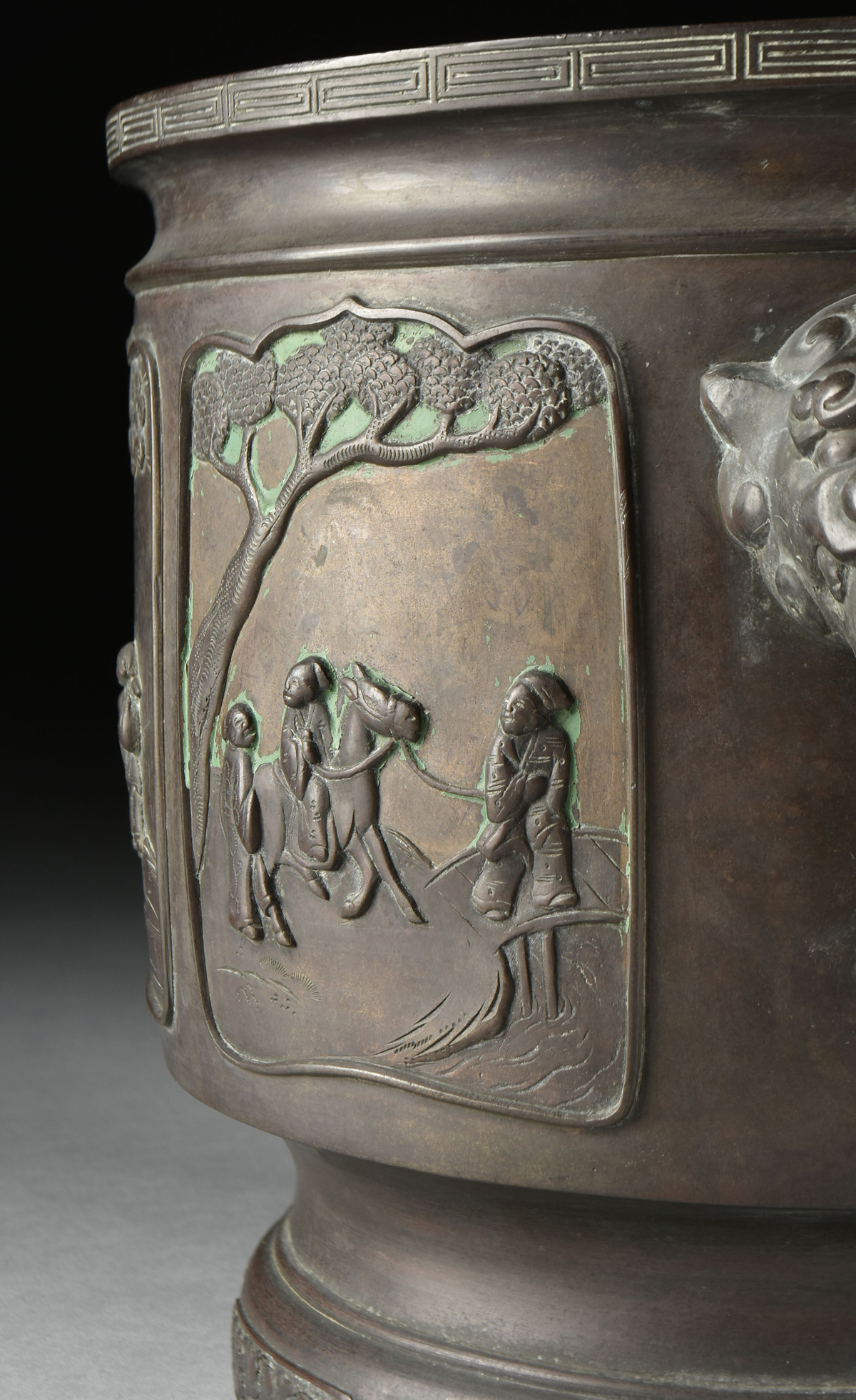 Lot 22 - A CHINESE RELIEF FIGURAL BRONZE CENSER, QING DYNASTY (1644-1912), of cylindrical form, the edge with