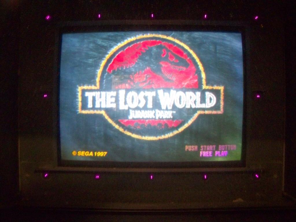 Lot 57 - LOST WORLD UPRIGHT SHOOTER ARCADE GAME SEGA