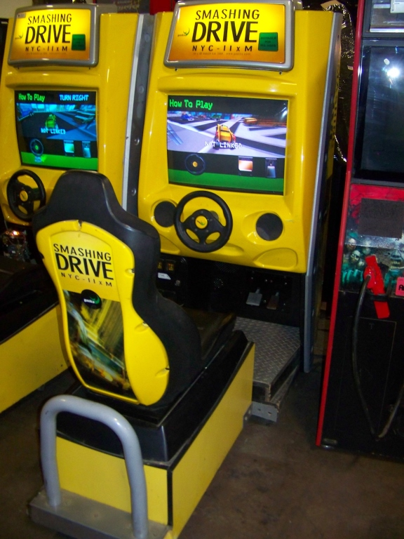 Lot 42 - SMASHING DRIVE NYC SITDOWN DRIVER ARCADE GAME