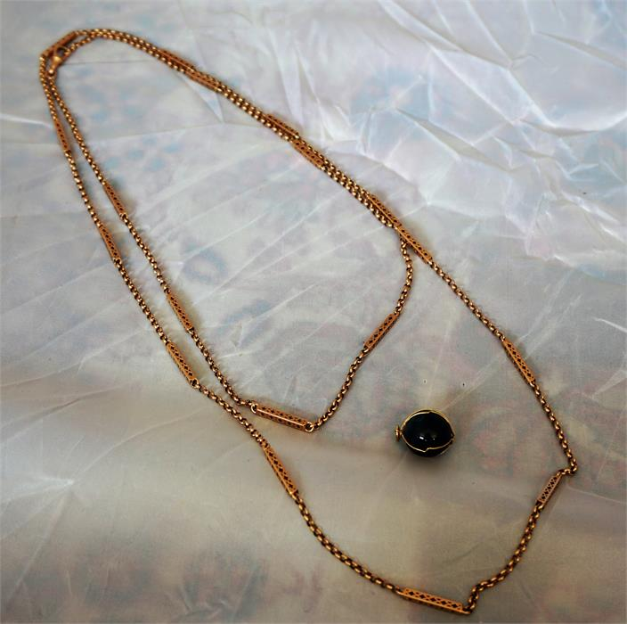 Lot 106 - 9ct Rose gold guard chain with Lapiz Lazuli style Spherical fob (chain 37.4 grams total weight