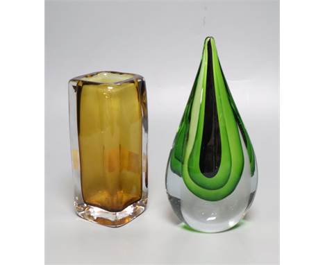 A Kosta amber glass vase and a green and clear glass ornament