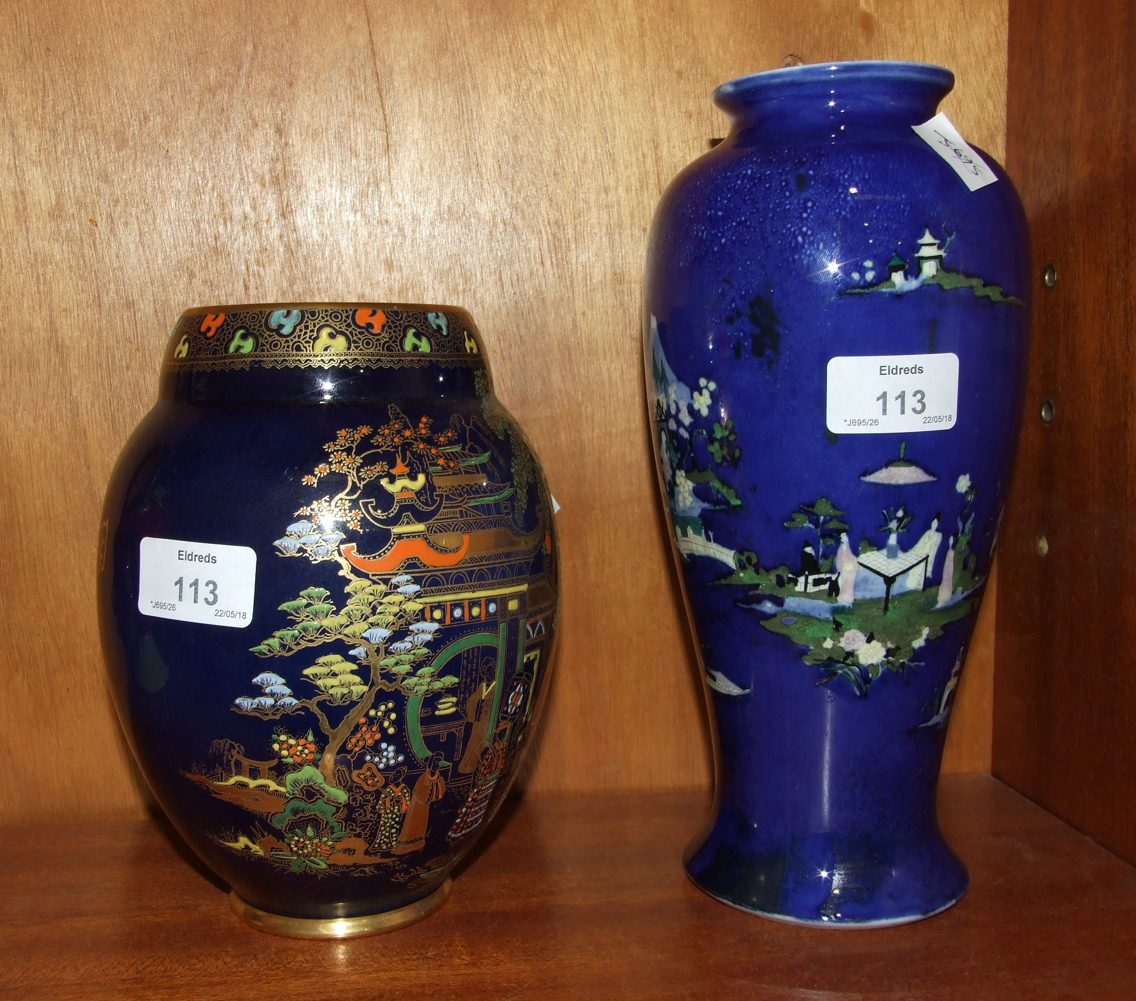 Lot 113 - A Wiltshaw & Robinson Carltonware baluster shape vase decorated with pagodas and figures on a blue