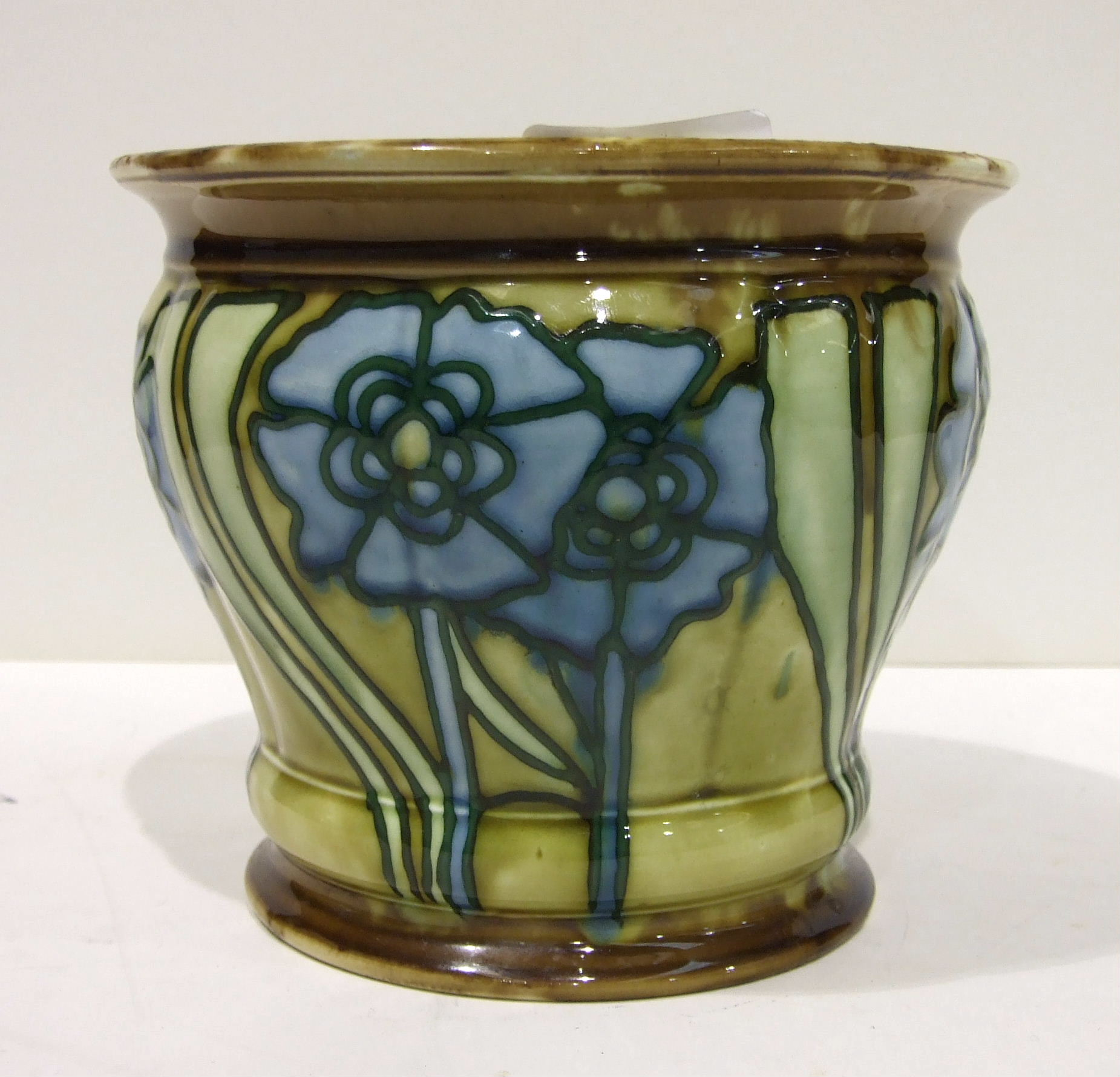 Lot 148 - A Minton Secessionist small jardinière decorated with tubeline blue stylised flowers, on a green and