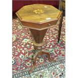 A Victorian walnut octagonal sewing table on carved tripod supports and a 20th century mahogany oval