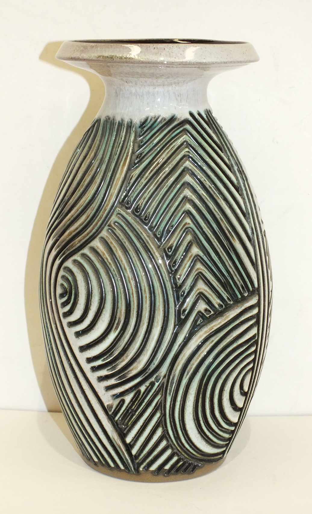 Lot 135 - A Poole Pottery Atlantis vase by Jenny Haigh, of ovoid form with flared rim, the body with incised
