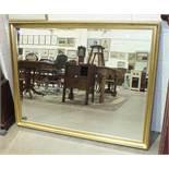 A modern gilt-framed rectangular wall mirror, 103.5 x 132cm.