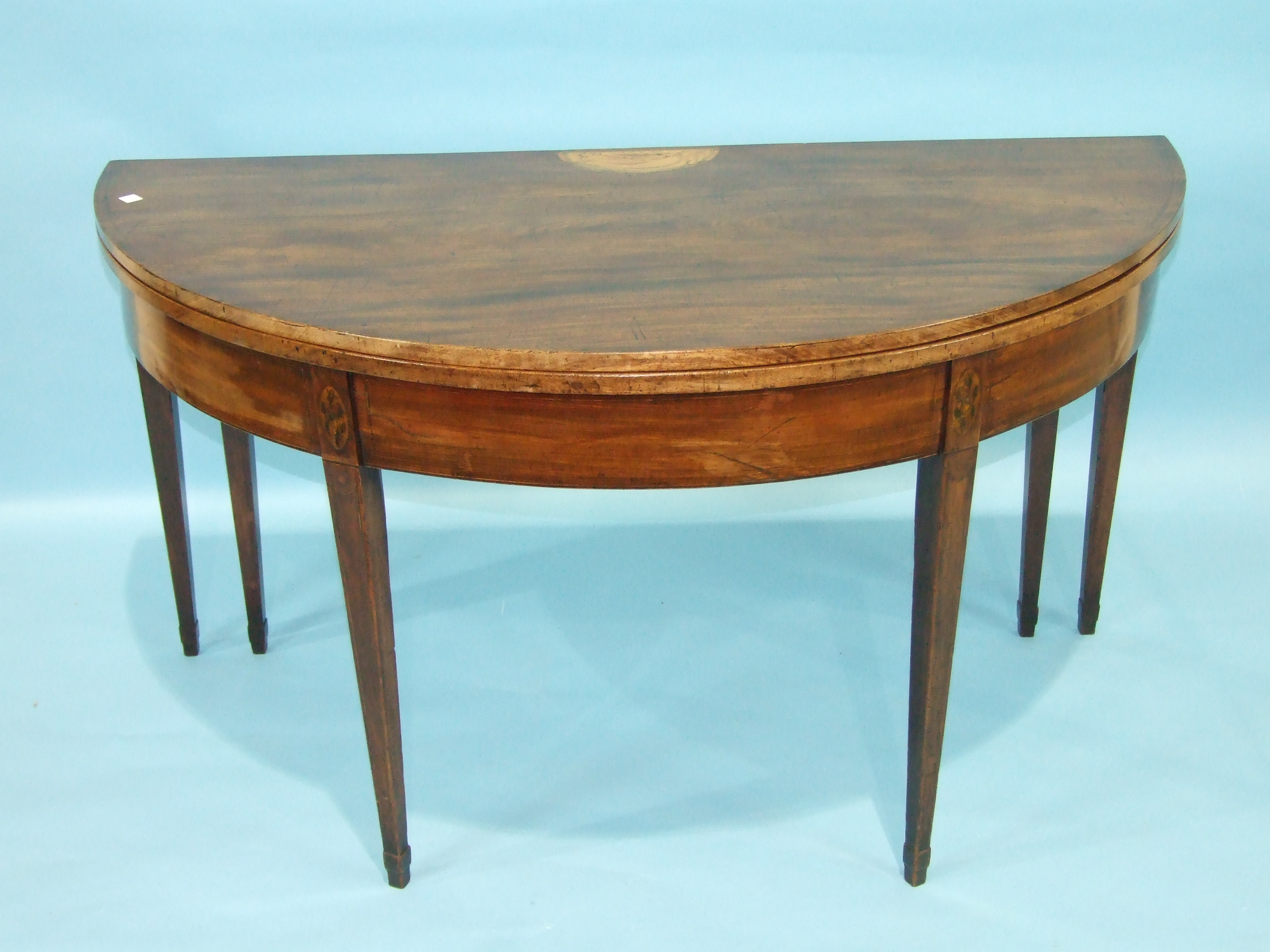 A Georgian mahogany gate-leg breakfast table, the circular fold-over top with inlaid shell motif, on - Image 2 of 2