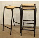 Nine painted tubular frame laboratory stacking stools with varnished plywood seats, (9).