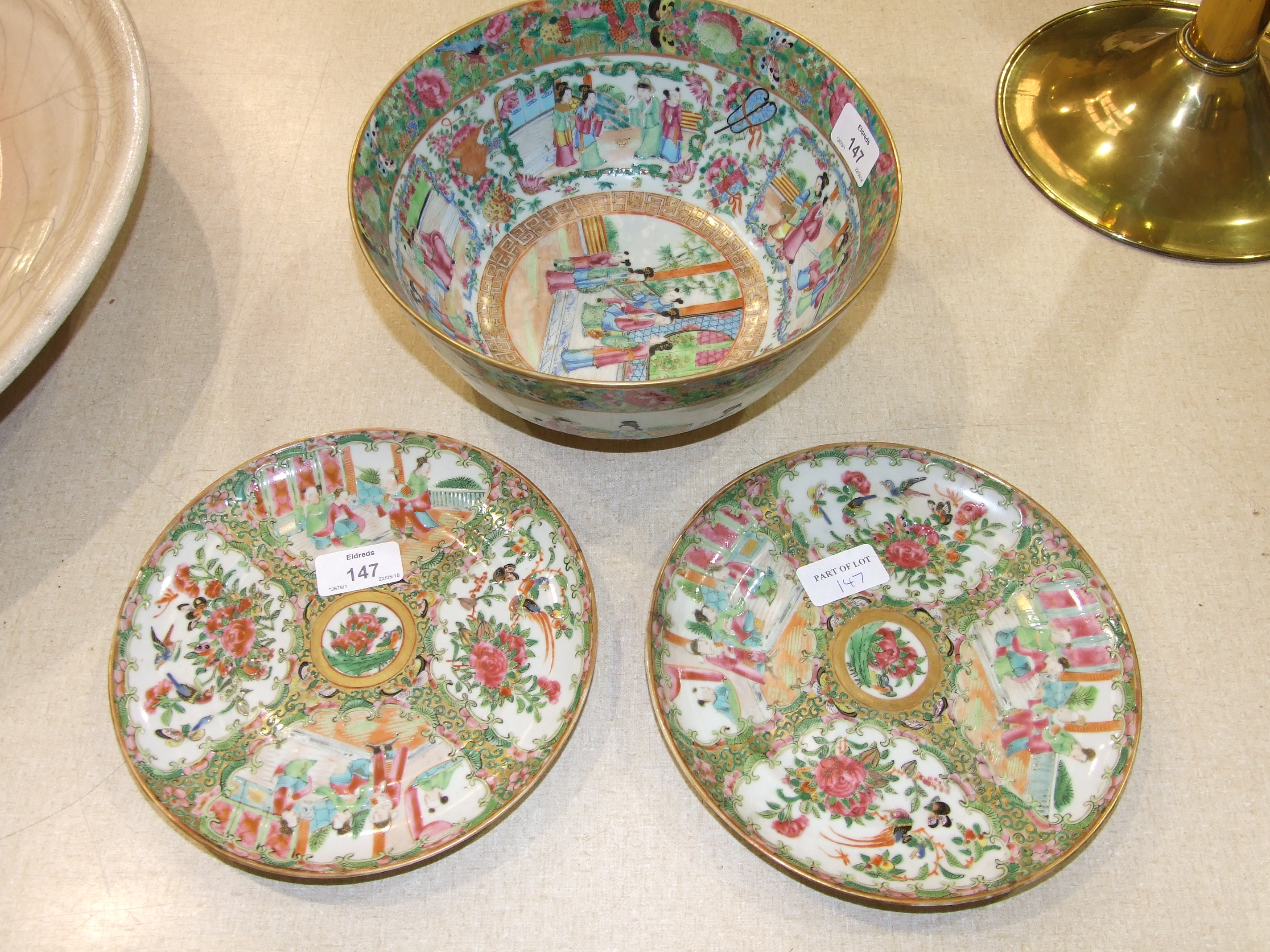 Lot 147 - A Canton bowl, typically-decorated with panels of figures within a border of flowers, birds and