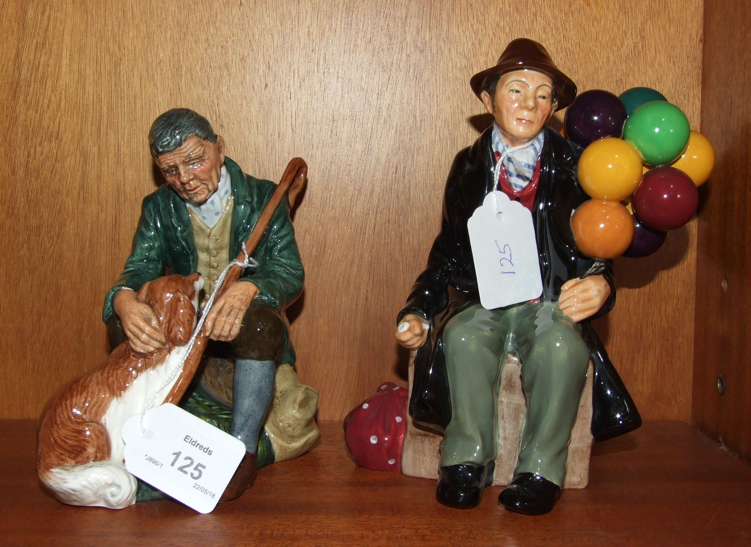 Lot 125 - Two Royal Doulton figures, 'The Balloon Man' HN1954, 20cm and 'The Master' HN2325, 17.5cm, (2).
