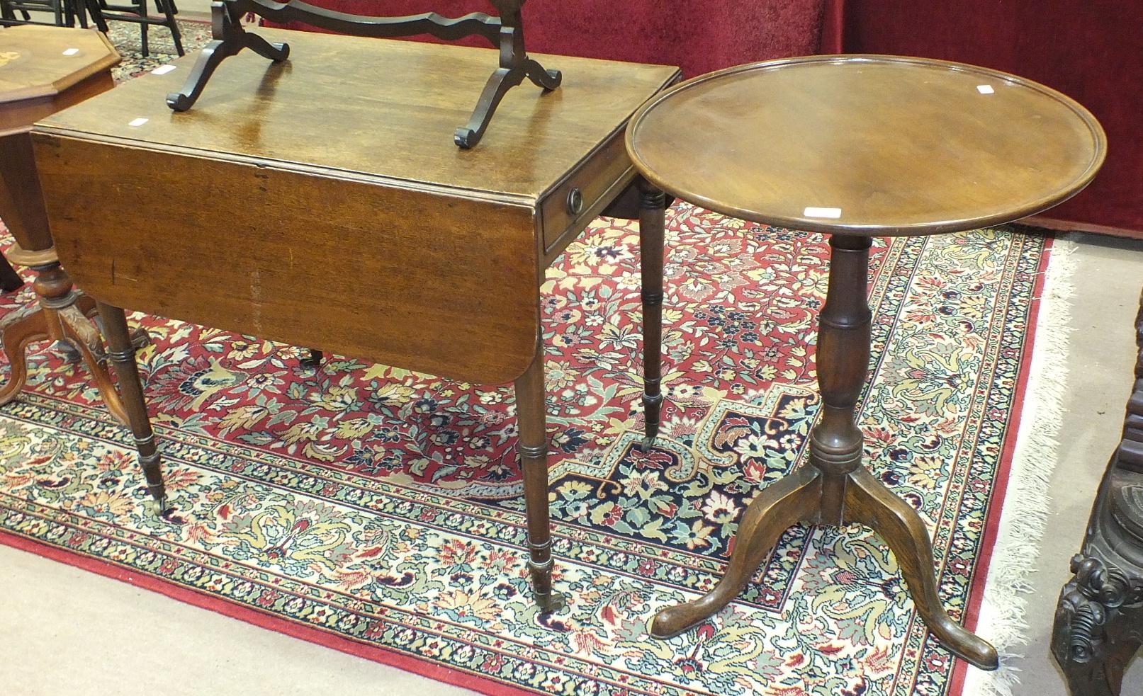 A mahogany circular occasional table on tripod support and a 19th century mahogany Pembroke
