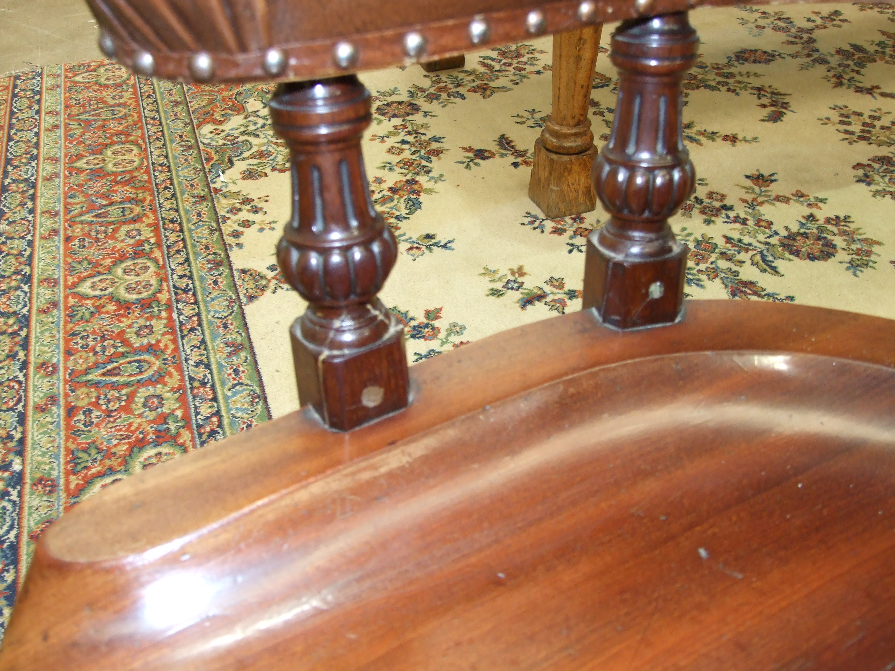 An early-19th century mahogany library chair, the open curved back and padded arms on carved - Image 2 of 2