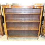 An Edwardian inlaid mahogany open bookcase, the brass galleried top above three adjustable