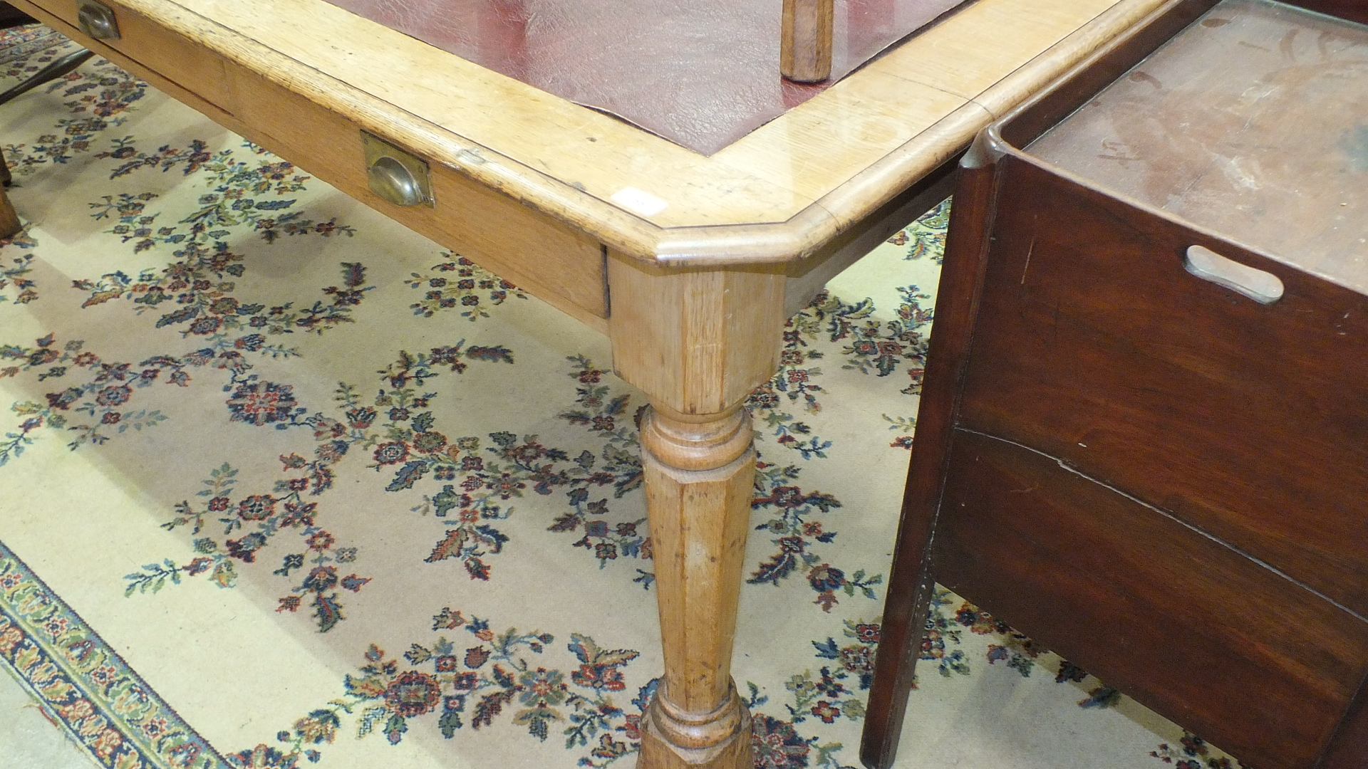 A Late-Victorian oak library table, the top inset with writing surface above three drawers, on - Image 3 of 3
