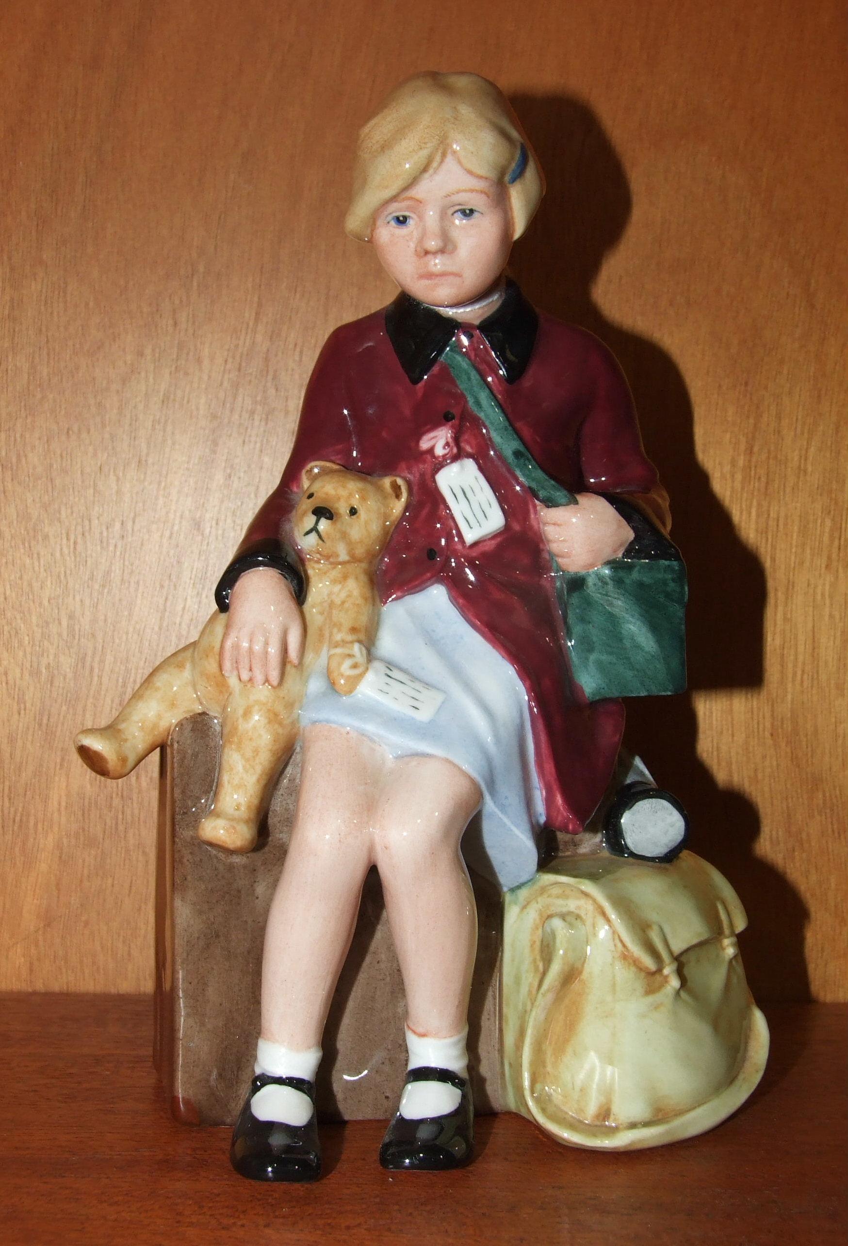 Lot 132 - A Royal Doulton figure 'The Girl Evacuee' HN3203, 20cm high.