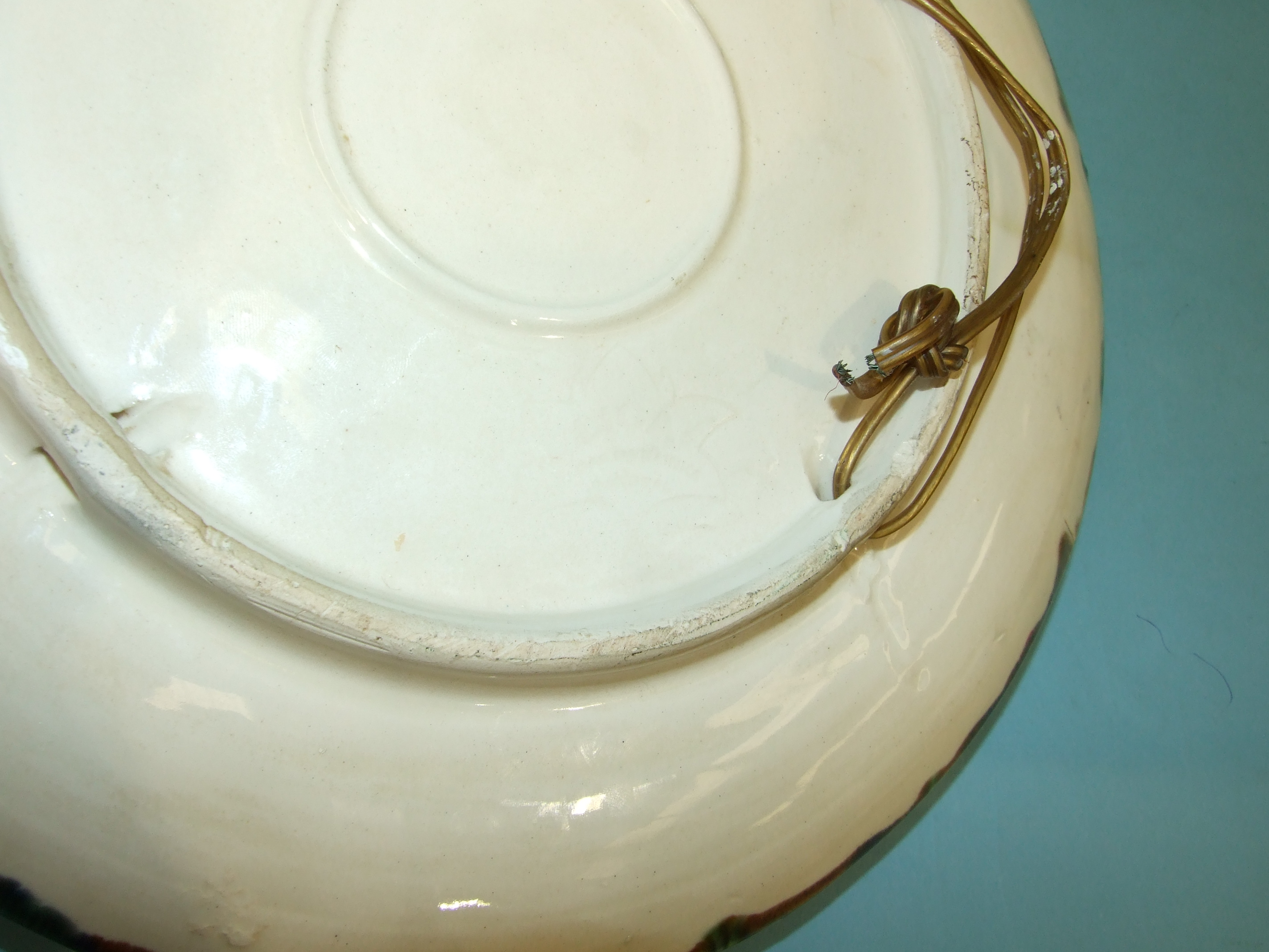 Lot 118 - A Portuguese Palissy Ware dish decorated in relief with a spider crab, mussels and other