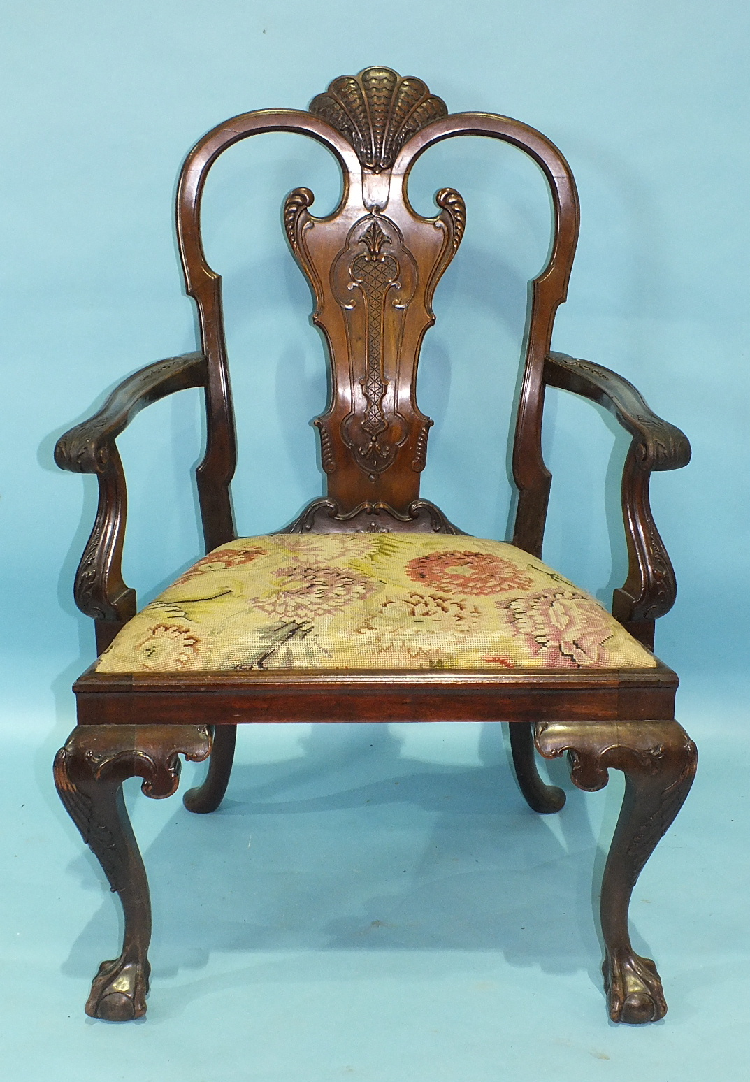 A Chippendale-style mahogany carver chair of generous proportions, the carved frame and drop-in seat