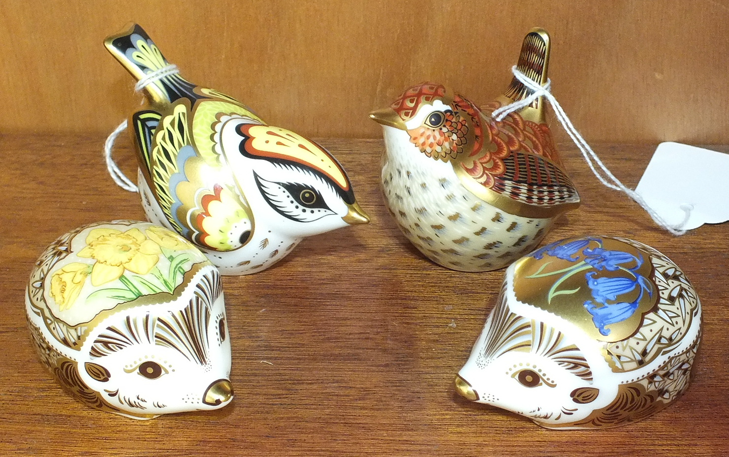 Lot 123 - A collection of four Royal Crown Derby porcelain paperweights, 'Jenny Wren', 6cm, 'Bluebell