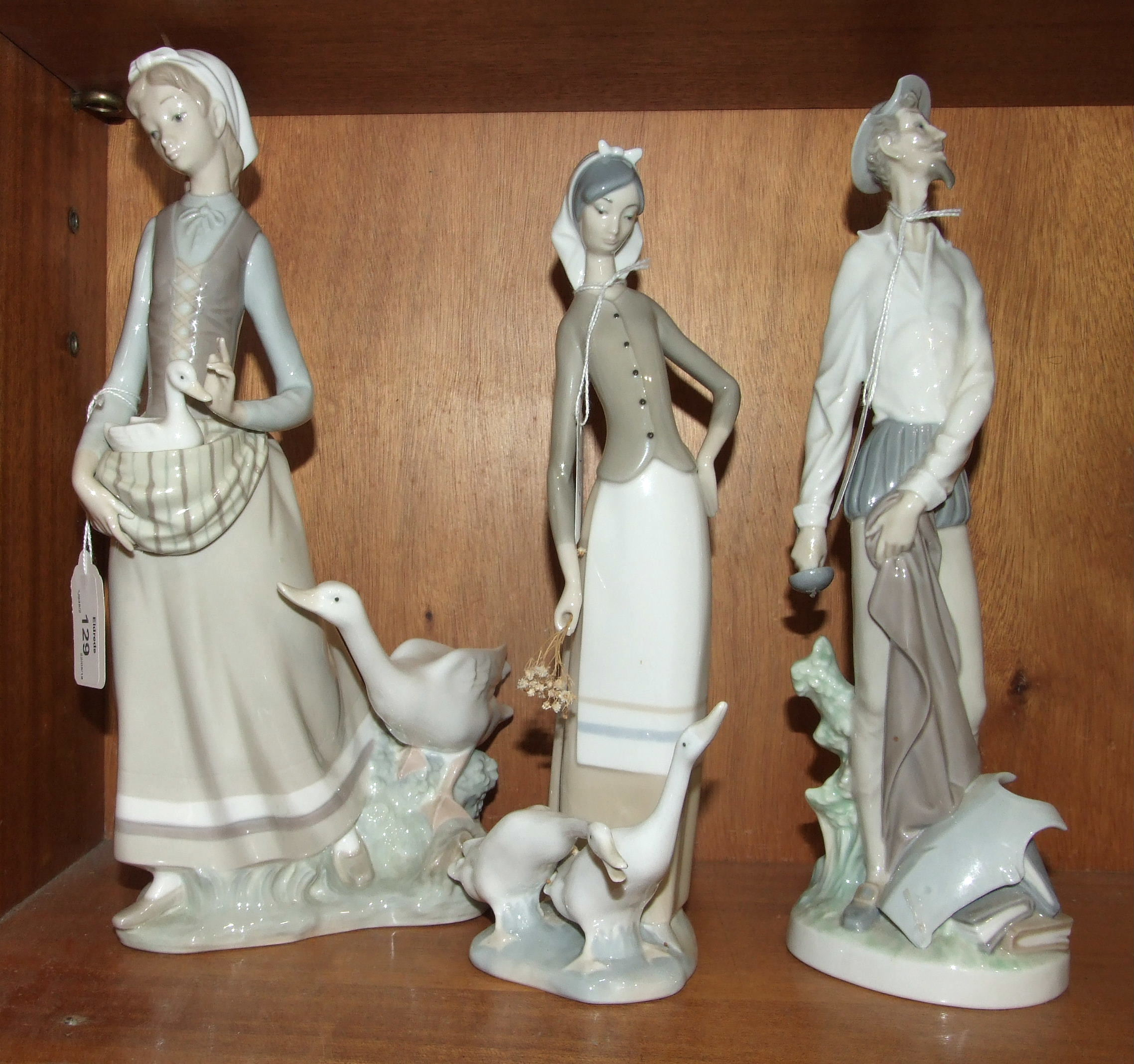 Lot 129 - Three Lladro figurines, 'Young girl carrying a duckling within her apron, with larger duck beside