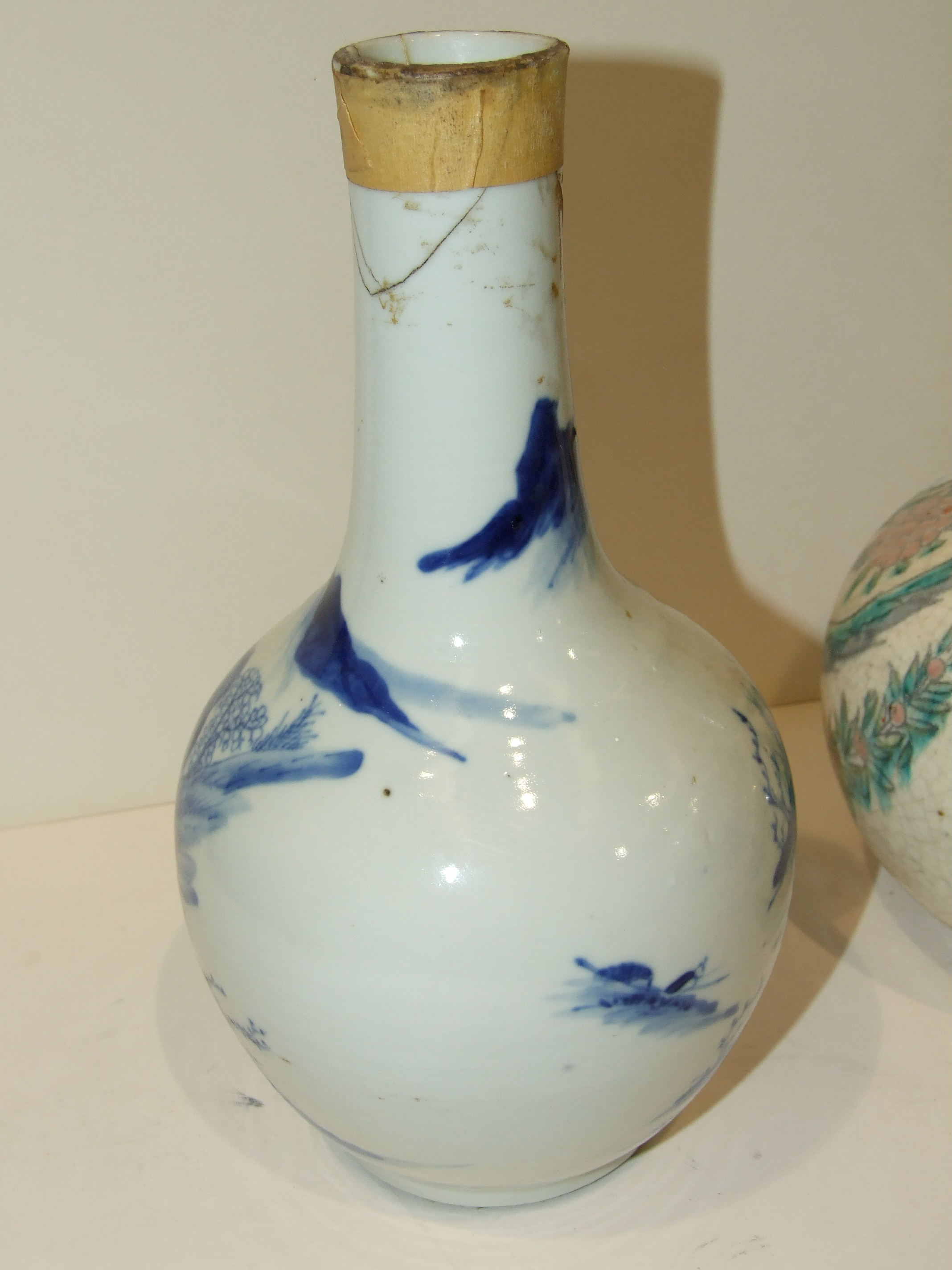 Lot 145 - A 19th century Chinese blue and white bottle vase, (damages), 24cm and another, both converted to