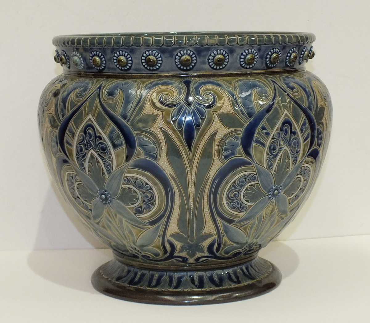 Lot 116 - A Doulton Lambeth stoneware jardinière by Edith D Lupton, dated 1881, with overall blue stylised