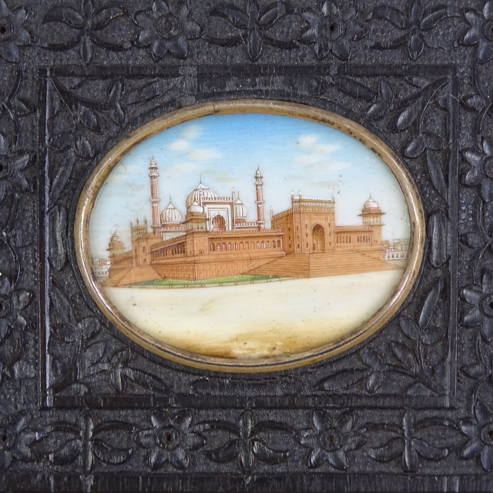 Lot 8 - A 19th century Indian miniature watercolour on ivory depicting temple buildings, in original