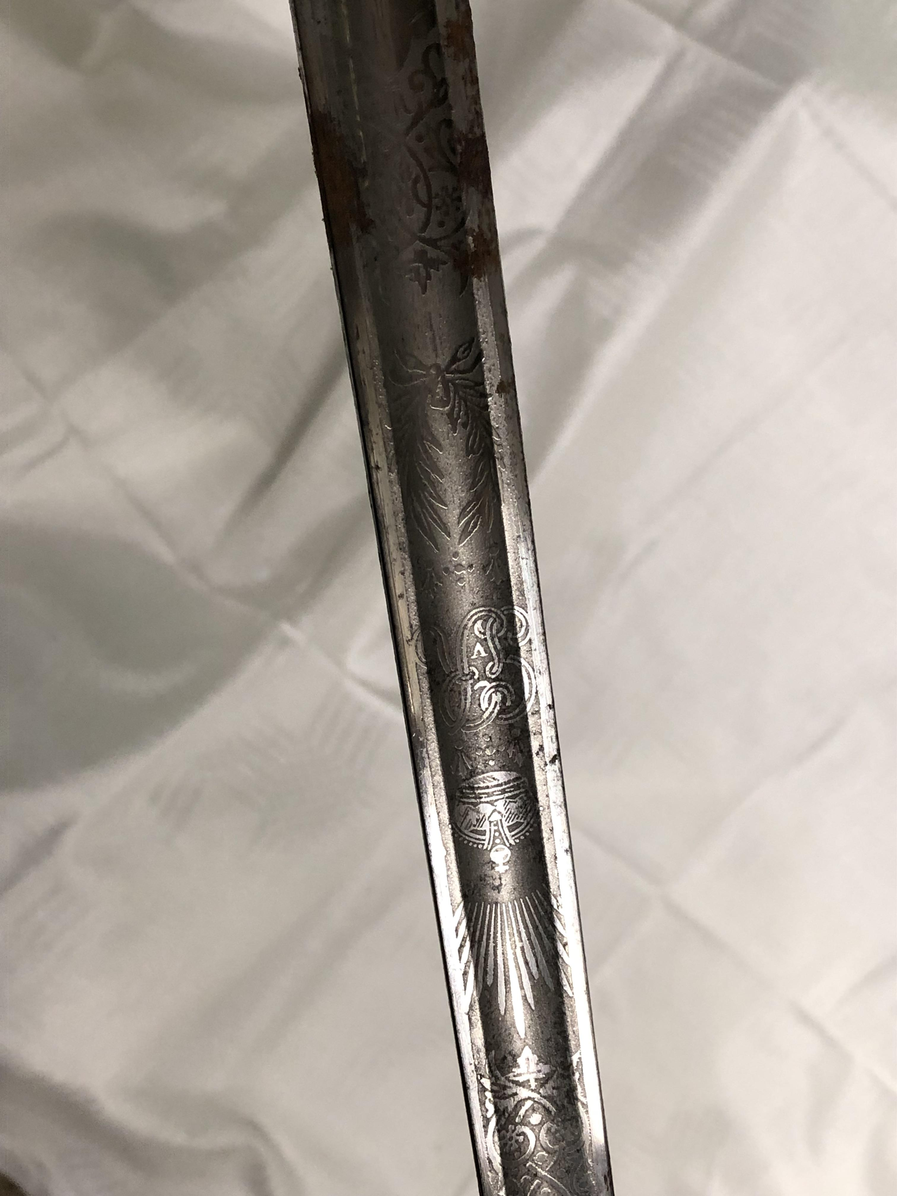 Lot 254 - MID 20TH CENTURY ETCHED BLADED DRESS SWORD WITH BASKET HILT IN A LEATHER SCABBARD (BLADE - 85CM L)