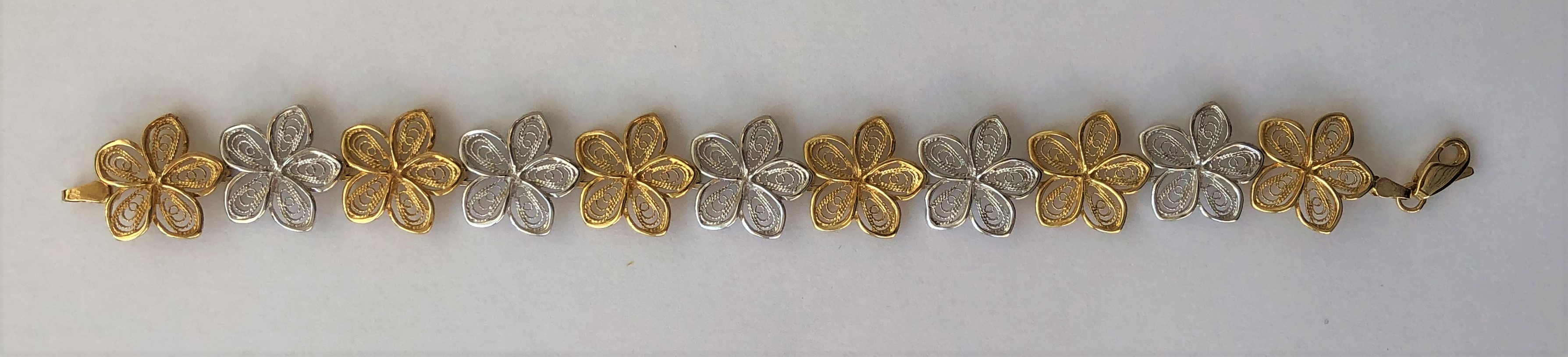 Lot 232 - 9CT YELLOW AND WHITE GOLD FILIGREE BRACELET 12.