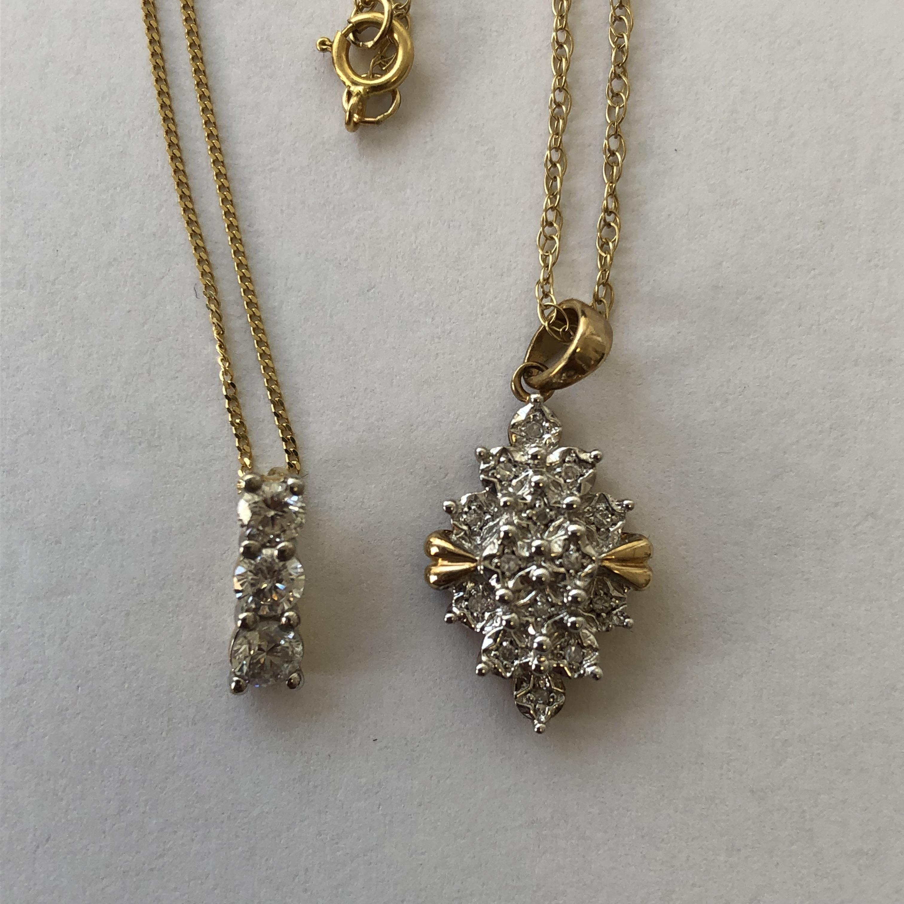 Lot 236 - 9CT GOLD AND CHIP DIAMOND PENDANT ON TRACE CHAIN AND A THREE STONE DIAMOND PENDANT ON TRACE CHAIN 4.