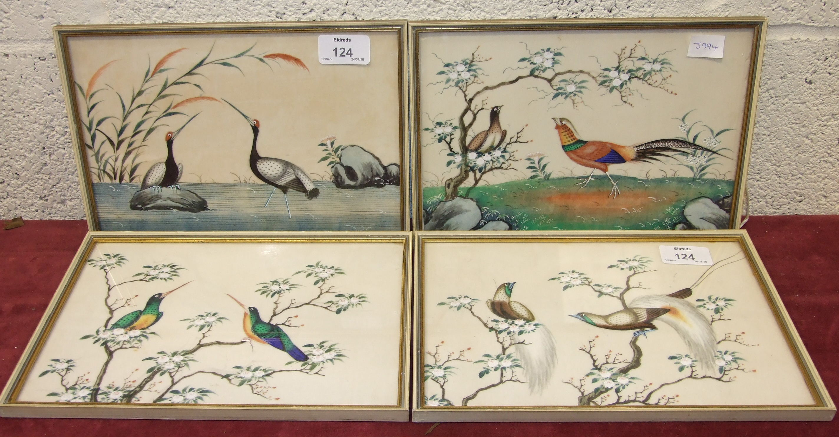 Lot 124 - Four early-20th century Chinese rice paper watercolours depicting exotic birds and flowering shrubs,