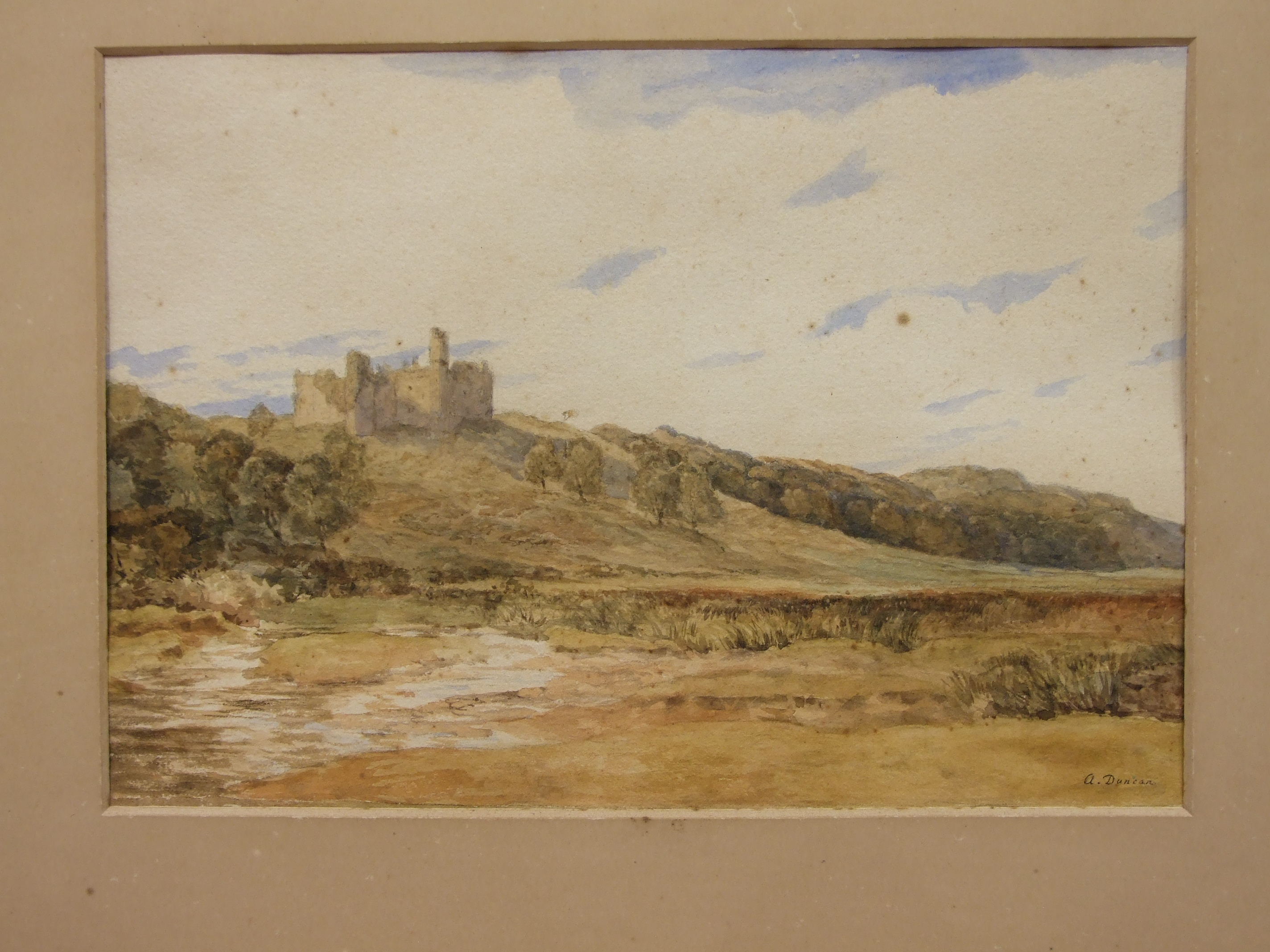 Lot 11 - Alan Duncan WEOBLEY CASTLE, COAST OF GOWER, SOUTH WALES Signed watercolour, titled on label verso,