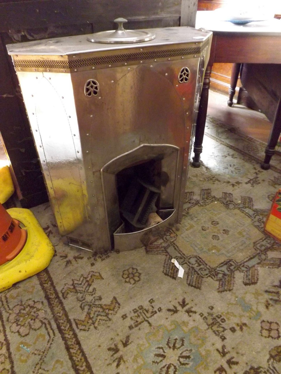 An Art Deco style chrome solid fuel burner being