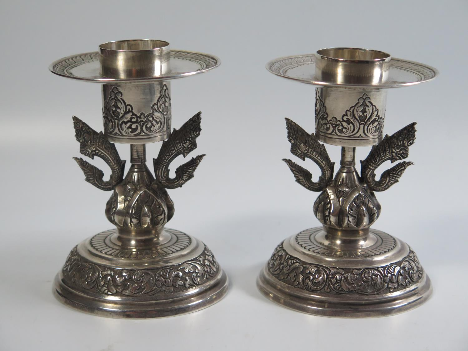 Lot 408 - A Pair of Cambodian Silver Candlesticks, marked THAN CAMBODGE TOCO, 263g, 10.5cm