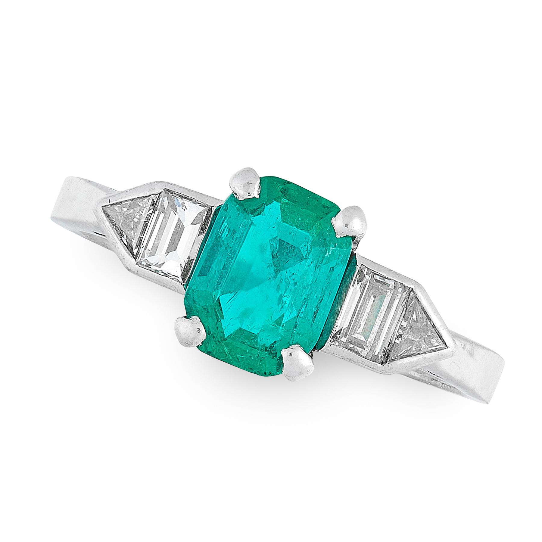 AN EMERALD AND DIAMOND DRESS RING set with an emerald cut emerald of 1.41 carats between geometric