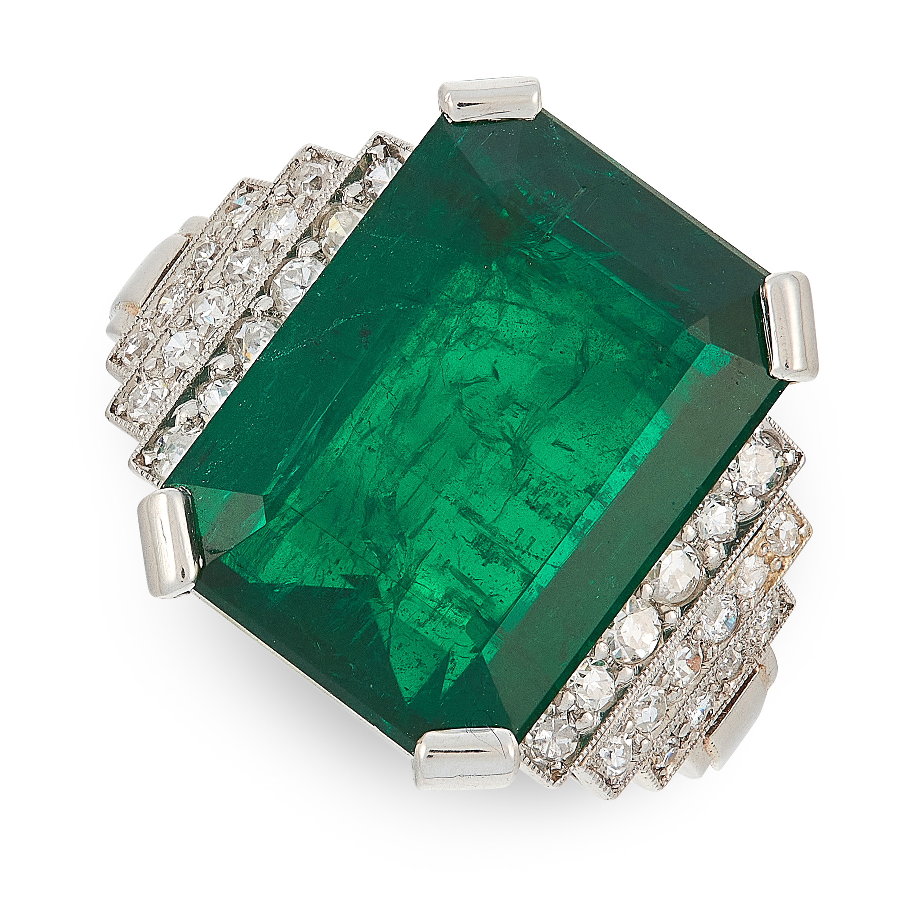 AN ART DECO EMERALD AND DIAMOND RING in platinum, set with an emerald cut emerald of 10.26 carats,