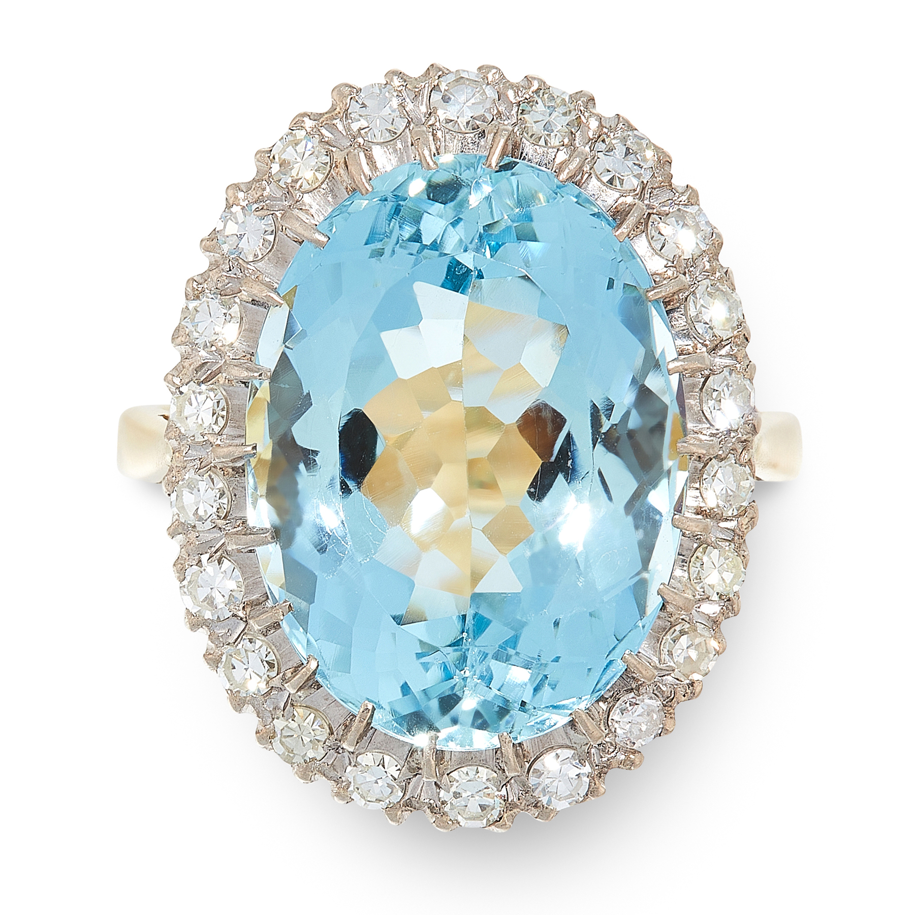 AN AQUAMARINE AND DIAMOND DRESS RING in 18ct yellow and white gold, set with an oval cut