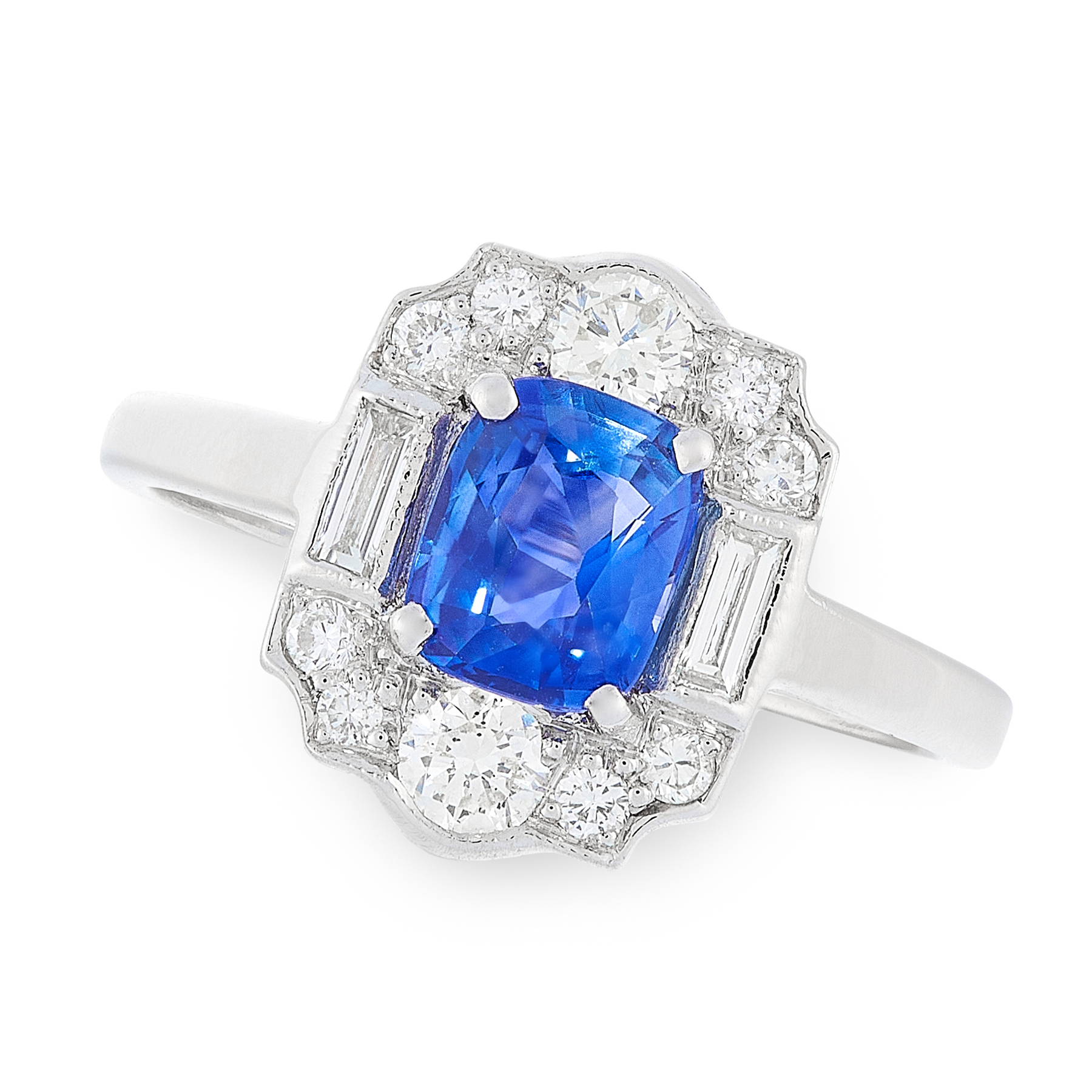 A SAPPHIRE AND DIAMOND DRESS RING in platinum, set with a cushion cut sapphire of 1.03 carats,