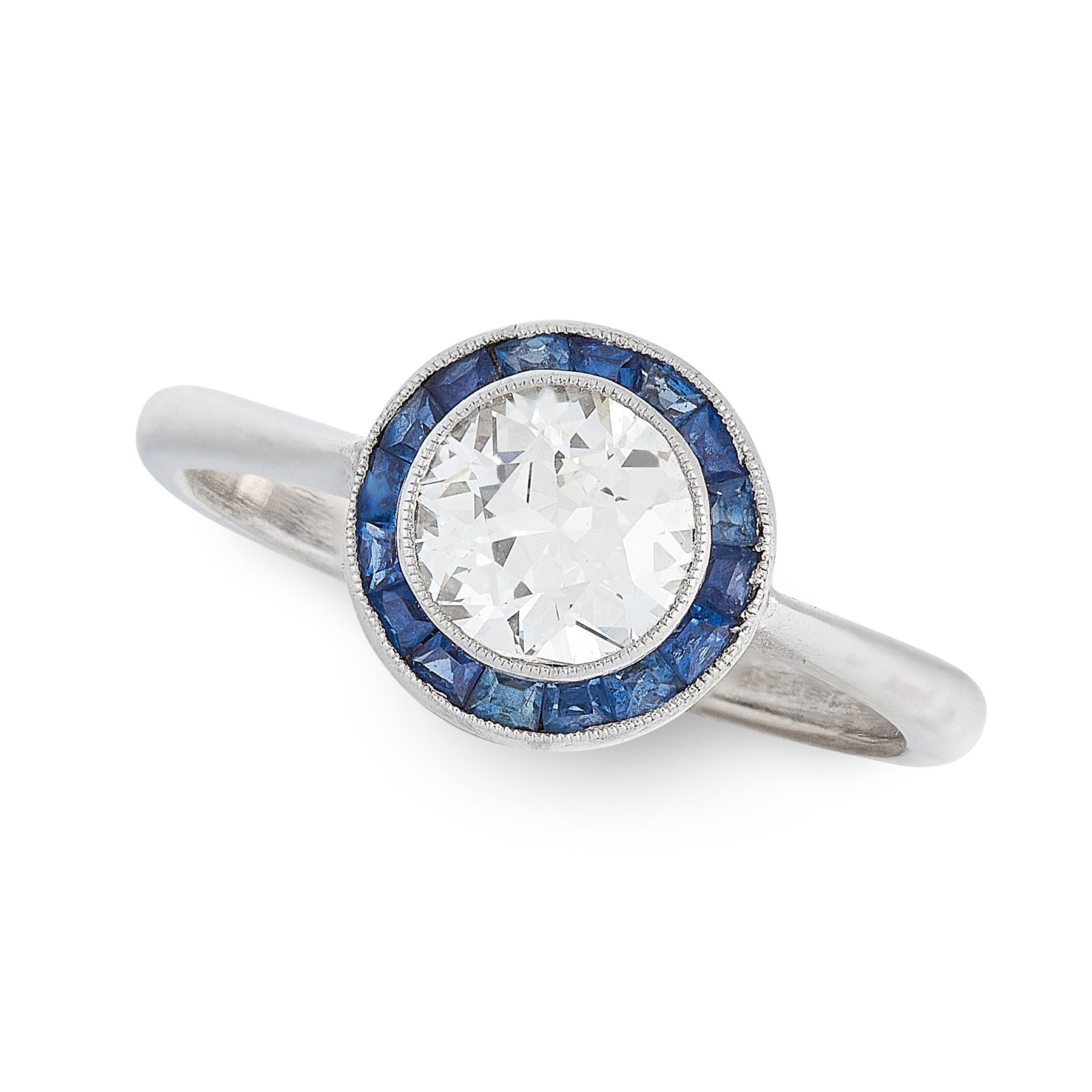 A DIAMOND AND SAPPHIRE TARGET RING set with an old cut diamond of 0.87 carats within a border of